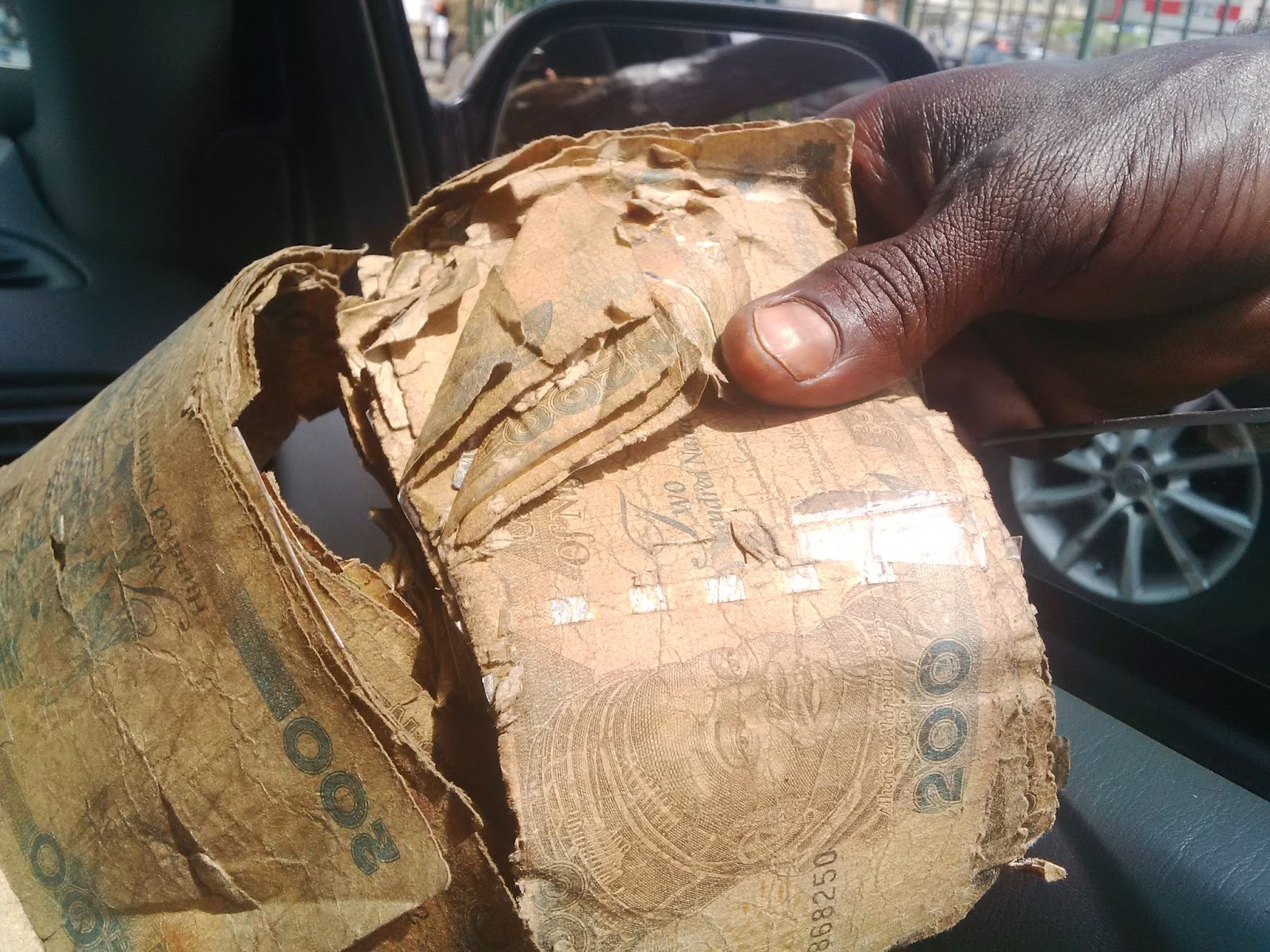 Access Bank Urges Customers to Hand Over Damaged Naira Notes
